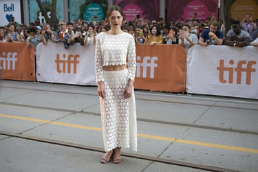 """Caren Pistorius poses for photographers as she arrives for the film """"Denial"""" during the 2016 Toronto International Film Festival in Toronto on Sunday, Sept. 11, 2016. (Chris Young/The Canadian Press via AP)"""
