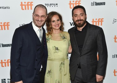 """Producer Darren Aronofsky, left, actress Natalie Portman and director Pablo Larrain attend the """"Jackie"""" premiere on day 4 of the Toronto International Film Festival at the Winter Garden Theatre on Sunday, Sept. 11, 2016, in Toronto. (Photo by Evan Agostini/Invision/AP)"""