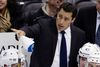 In this Feb. 24, 2013, file photo, Tampa Bay Lightning head coach Guy Boucher gives instructions from behind his bench in Pittsburgh. (AP Photo/Gene J. Puskar, File)