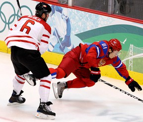Canada's Shea Weber (left) trips up Russia's Maxim Afinogenov during hockey action at the Vancouver Winter Olympics on Feb. 24, 2010. (Andre Forget/Postmedia Network/Files)