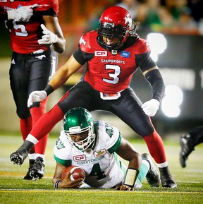 Taylor Reed (3), seen here with the Stampeders celebrating after bringing down quarterback Darian Durant of the Roughriders last month, could face his former team after he signed with the Redblacks on Tuesday. (Al Charest/Postmedia Network)