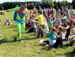 Captain Positive receives an enthusiastic freeing from students a McNaughton Avenue Public School in Chatham, Ont. during Positivity Day in C-K on Tuesday September 13, 2016. (Ellwood Shreve/Chatham Daily News)