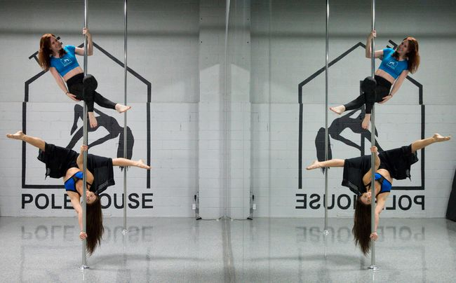 The Pole House co-owners Melissa Clackett, top, and Emily Kelman, bottom, dance on a pole in their Adelaide Street studio in London, Ont. on Tuesday September 13, 2016. The fitness studio owners have decided to voluntarily withdraw their presence at Take Back The Night following criticism from the London Abused Women's Centre.  Craig Glover/The London Free Press/Postmedia Network