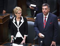 Premier Kathleen Wynne and Finance Minister Charles Sousa at Queen's Park. (The Canadian Press)