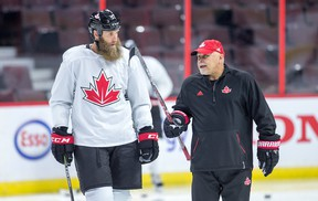 Joe Thornton talks with coach Barry Trotz as Team Canada practicesn preparation for the World Cup of Hockey Tournament.