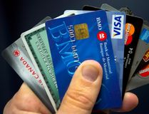 Credit cards are displayed in Montreal, Wednesday, December 12, 2012. The amount Canadians owe compared with how much they earn hit a new record in the second quarter, driven in part by the country's hot housing markets. THE CANADIAN PRESS/Ryan Remiorz