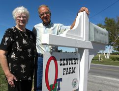 Ernst Kuglin/The Intelligencer Ron and Janet Hamilton stand by the Century Farm sign at their Hamilton Road family farm. The Quinte West couple, along with five other nominees, will be inducted to the Wall of Fame at Farmtown Park in Stirling Sunday afternoon at 2 p.m.