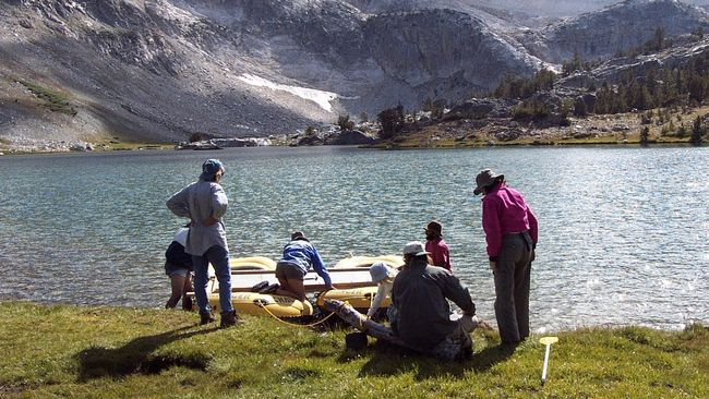 Katrina Moser and members of her research team prepare for core sampling. (Supplied photo)