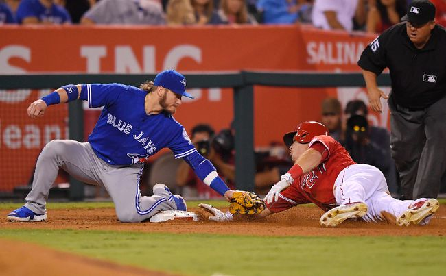 Angels' Mike Trout (right) steals third as Blue Jays third baseman Josh Donaldson puts a late tag on him during sixth inning MLB action in Anaheim, Calif., on Saturday, Sept. 17, 2016. (Mark J. Terrill/AP Photo)