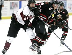 Chatham Maroons' Alec MacKenzie (61) collides with Sarnia Legionnaires' Brett Storr (18) in the first period Sunday at Memorial Arena. (MARK MALONE/The Daily News)