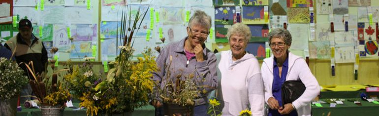 Long-time friends Judy Chilvers (left), and Jane Dearmo, of London, met up with Sharon Smith of Wiarton to enjoy the 148th Wiarton Fall Fair displays at the Wiarton Arena, Sept. 16. Photo by Zoe Kessler/Wiarton Echo