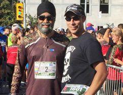 Afghanistan veterans retired master corporal Collin Fitzgerald, right, and Minister of National Defence Harjit Sajjan pose for a photo at the Canada Army Run in Ottawa on Sunday. Fitzgerald carried bib number 1601 in memory of Maj. Michelle Mendes. (Photo courtesy Kerri Tadeu)