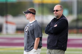 Brock Sunderland (L), Assistant General Manager and Marcel Desjardins, General Manager of the Ottawa RedBlacks during morning practice in Ottawa, August 26, 2015. Time 12:24 (Jean Levac/ Ottawa Citizen)