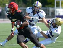 Central Secondary defenders Griffin Campbell, centre, and Quinn Currado, right, collide while trying to tackle Saunders receiver Noel Franklin during the opening game in the United Way tournament played at TD Waterhouse Stadium at Tuesday September 20, 2016. (MORRIS LAMONT, The London Free Press)