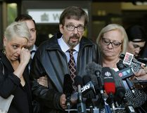 Bret McCann, centre, his wife Mary-Ann McCann, right, and their daughter Nicole Walshe, left, speak to media outside the Edmonton law court after the conviction of Travis Vader. The case is covered in Deadmonton: Crime Stories from Canada's Murder City.