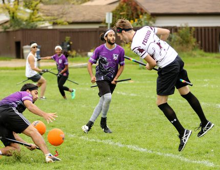 A Calgary Kelpies beater, left, gets hit by a bludger sent his way by his Edmonton Aurors opponent during a quidditch Match at the Bower Community Centre Field in Red Deer Sunday afternoon as part of the region's first quidditch festival. The event was hosted by Central Alberta Quidditch, which has attracted players from Ponoka and Lacombe to play the sport inspired by the Harry Potter series. (Ashli Barrett, Lacombe Globe)