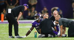 In this Sept. 18, 2016, file photo, Minnesota Vikings running back Adrian Peterson talks with head coach Mike Zimmer, left, after getting injured during the second half of an NFL football game against the Green Bay Packers, in Minneapolis. (AP Photo/Jim Mone, File)