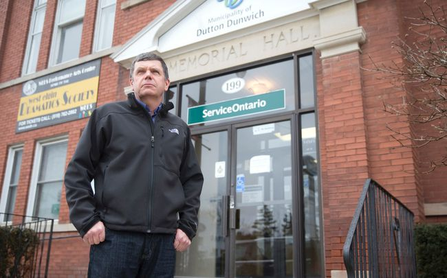 Mayor Cameron McWilliam on the front steps of the Dutton/Dunwich municipality offices in Dutton in this March 2016 file photo. The mayor learned at that time of plans to install a number of wind turbines on properties within his township.