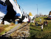 Women from Q99 and Victoria's Attic hang bras donated to the lingerie store by customers between the Richmond Avenue and 99 Avenue bridges in Grande Prairie,during last year's Bras Across the Bridge event. DHT file photo