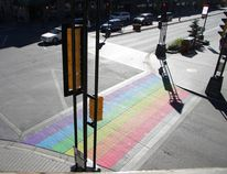 Part of the intersection at Caribou Street and Banff Avenue was painted on Wednesday, Sept. 30, 2015 with rainbow colours to celebrate Banff Pride 2015. Banff Pride returns to Wild Bill's Saturday, Oct. 1, 2016. (Russ Ullyot/ Crag Canyon Archives)