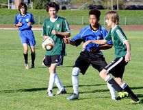 Braeden Chalwell, of the Timmins High & Vocational School Blues, plays the ball between Roland Michener Secondary School Rebels defenders Ryan Tayler, left, and Hans Parnell during a NEOAA Central Division Boys Soccer exhibition game at the Timmins Regional Athletics and Soccer Complex on Tuesday. The Blues scored a 6-0 victory in their final preseason tuneup. The two sides will open the regular season against each other at RMSS on Monday. THOMAS PERRY/THE DAILY PRESS
