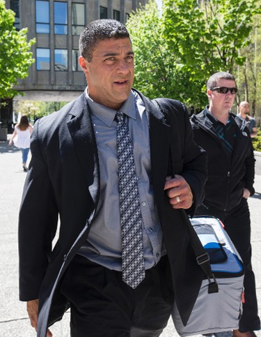 York Regional Police Det.-Const. Remo Romano leaves 361 University Ave. courthouse after his first trial ended in a hung jury May 18, 2016. (Craig Robertson/Toronto Sun)