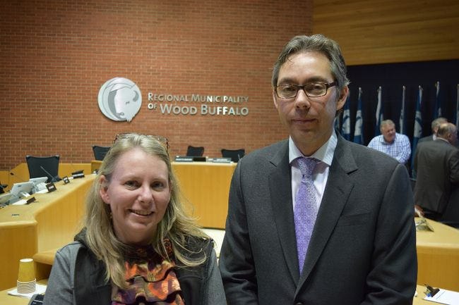 Habitat for Humanity Wood Buffalo executive director Crystal Lewis-Wilton and Wood Buffalo Housing acting CEO Greg Elsasser stand in council chambers during a recess, after presenting a proposal to help uninsured and underinsured fire victims in Fort McMurray, Alta. on Sept. 21, 2016. Cullen Bird/Fort McMurray Today/Postmedia Network.