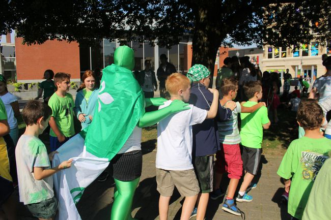 A staff member in a Franco-Ontarian-themed morph suit joins a conga line at Museum Square on Thursday, Sept. 22, when Sainte-Marguerite-Bourgeoys and Notre Dame students gathered to celebrate Franco-Ontarian Day. (MEGAN STACEY/Sentinel-Review)