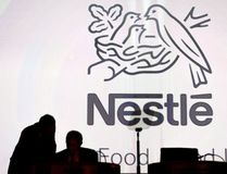 """Nestle's directors speak in front of the Nestle's logo during the general meeting of the world's biggest food and beverage company, Nestle Group, in Lausanne, Switzerland, April 7, 2016. A small but fast growing Ontario community looking for a safe drinking water supply has been outbid in its attempt to buy a well by multinational giant Nestle, which acquired the site to ensure """"future business growth."""" THE CANADIAN PRESS/Laurent Gillieron/Keystone via AP,file)"""