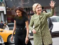 Democratic presidential candidate Hillary Clinton (R) waves as she arrives to talk with patrons at the Jackson Diner on April 11, 2016 in the Flushing neighborhood of the Queens borough of New York City. (Photo by Andrew Theodorakis/Getty Images)