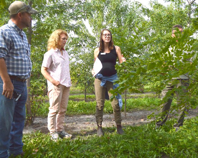 Amanda Blain, with the LTVCA, talks with attendees of the conservation group's Farm to Coast tour Sept. 22. They want to promote tree-planting initiatives in Chatham-Kent like the 50 Million Tree Program. (Louis Pin/Postmedia Network)