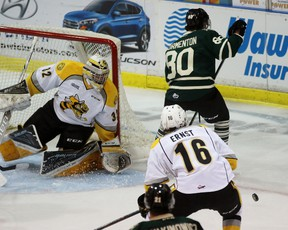 Sarnia Sting goalie Justin Fazio stops a shot from London Knights forward Alex Formenton during the Ontario Hockey League game at Progressive Auto Sales Arena on Wednesday September 21, 2016 in Sarnia, Ont. Formenton, a 17-year-old forward from King City, Ont., made his Knights debut. (Terry Bridge/Sarnia Observer/Postmedia Network)