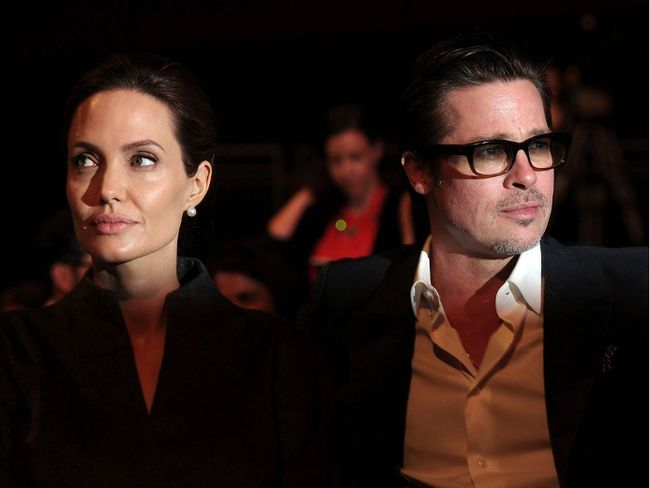 This file photo taken on June 13, 2014 shows US actress and special UN envoy Angelina Jolie (L) and her husband US actor Brad Pitt attending the fourth day of the Global Summit to End Sexual Violence in Conflict in London. US actress Angelina Jolie has filed for divorce from her husband Brad Pitt after two years of marriage and 12 years together, announced on September 20, 2016 by the website TMZ celebrity. (CARL COURT/AFP/Getty Images)