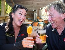 Kerri Salki (l) and Tom McGouran toast each other on a local patio in Winnipeg, Man. Thursday September 22, 2016. The pair will be co-hosting The Drive on 94.3FM starting Monday.