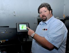 Brockville Arts Centre theatre technician Michael Sherman explains the workings of the facility's new movie projector on Thursday. (RONALD ZAJAC/The Recorder and Times)