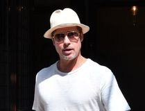 Brad Pitt out and about in New York wearing a white outfit and hat. (TNYF/WENN.com)