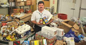 Myles Vanni, executive director of the Inn of the Good Shepherd, is pictured in October, 2011 showing off the results of the agency's Thanksgiving Food Drive. This year the Inn's is aiming to raise 40,000 pounds of food in its annual donation drive. (Observer file photo)