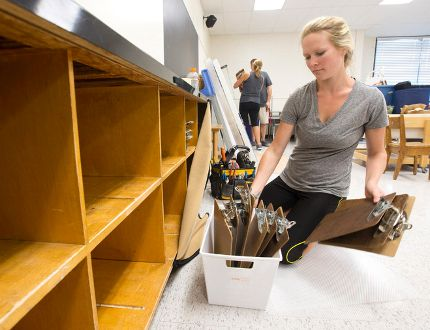 Early childhood educator Stephanie Gillan puts clipboards into a cubby hole in a kindergarten classroom at Ekcoe Central Public School in Glencoe, Ont. on Friday September 23, 2016. The school was closed at the beginning of the school year and cleaned after the discovery of mould, and will reopen on Monday. (CRAIG GLOVER, The London Free Press)
