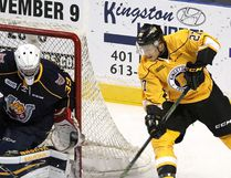 Kingston Frontenacs Cody Caron tries a wraparound on Barrie Colts goalie David Ovsjannikov during Ontario Hockey League action at the Rogers K-Rock Centre on Friday September 23 2016. Ian MacAlpine /The Whig-Standard