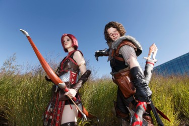 Daina Friend (left), as Leliana, and Lane Monteith, as Hawke, from Dragon Age pose for a photo during the Edmonton Comic & Entertainment Expo at the Edmonton Expo Centre in Edmonton, Alberta on Saturday, September 24, 2016. Ian Kucerak / Postmedia