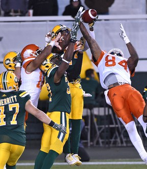 With 3 seconds left the BC Lions try a hail mary pass in the end zone for Emmanuel Arceneaux (84) but got incepted by the Edmonton Eskimos during CFL action at Commonwealth Stadium in Edmonton Friday, September 23, 2016.