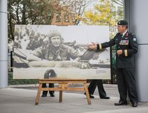 Brigadier-General Simon Hetherington with a portrait of Major-General Bertram Hoffmeister at the ribbon cutting ceremony for the Hoffmeister Building. Bombardier Albert Law, 39 CBG Public Affairs