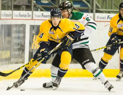 Jake Elmer moves the puck up the ice and out as the Thunder's Andrew Troy tries to stop him. The Storm hosted the Drayton Valley Thunder for their home opener at Revolution Place Friday in a high scoring 8-4 affair. Randy Vanderveen/Special to Daily Herald-Tribune