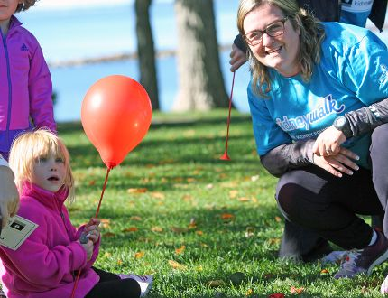 Allie Kauenhofen, 5, and her mother Sandy at the Kidney Foundation's Kidney Walk at Lake Ontario Park on Sunday morning. (Steph Crosier/The Whig-Standard)