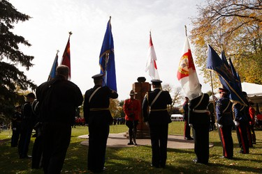 The colour party and honour guards surround the Pillar of Strength during Alberta's Police and Peace Officers' Memorial Day at the Alberta Legislature in Edmonton, Alberta on Sunday, September 25, 2016. Ian Kucerak / Postmedia