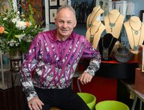 Jim Telfer shows off his sense of style at his London store Splash, a home-decor business located at 57 York St. (MORRIS LAMONT, The London Free Press)