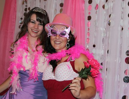 Carly Verville and Samantha Ladouceur clown around with some of the props in a photo booth set up at the annual Night on the Town in Your Gown fundraiser. The event was held on Saturday evening in Timmins in support of breast cancer research.