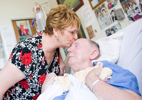 Edmonton - July 22, 2009 - Lesley Miller spends time with her husband Dougald Miller, who must live in a full time care facility due to injuries he received from a beating in 2002. Lesley has become an outspoken advocate for victims rights.