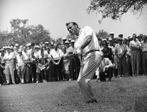 """This April 29, 1962, file photo shows Arnold Palmer, lifting an iron shot from No. 5 fairway in the final round of the Texas Open in San Antonio. Palmer, who made golf popular for the masses with his hard-charging style, incomparable charisma and a personal touch that made him known throughout the golf world as """"The King,"""" died Sunday, Sept. 25, 2016, in Pittsburgh. He was 87. (AP Photo/Ted Powers) ORG XMIT: NY154"""