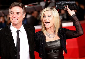 Actress Olivia Newton-John, right, and John Easterling attend the 'A Few Best Man' premiere during the 6th International Rome Film Festival at Auditorium Parco Della Musica on Oct. 28, 2011, in Rome, Italy. (Vittorio Zunino Celotto/Getty Images for Lancia)